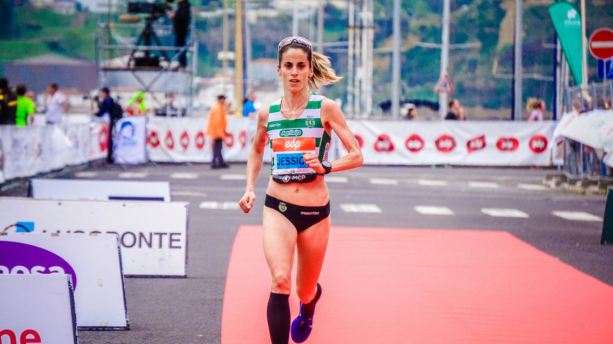 How-To-Economize-With-Glycogen-In-A-Marathon-Woman-at-the-marathon-finish-line
