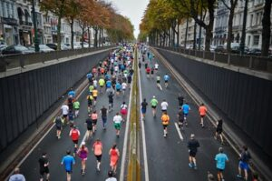 How-To-Finish-A-Marathon-Race-The-Endurance-Way-Participants-in-a-distance-race-coming-up-from-a-tunnel