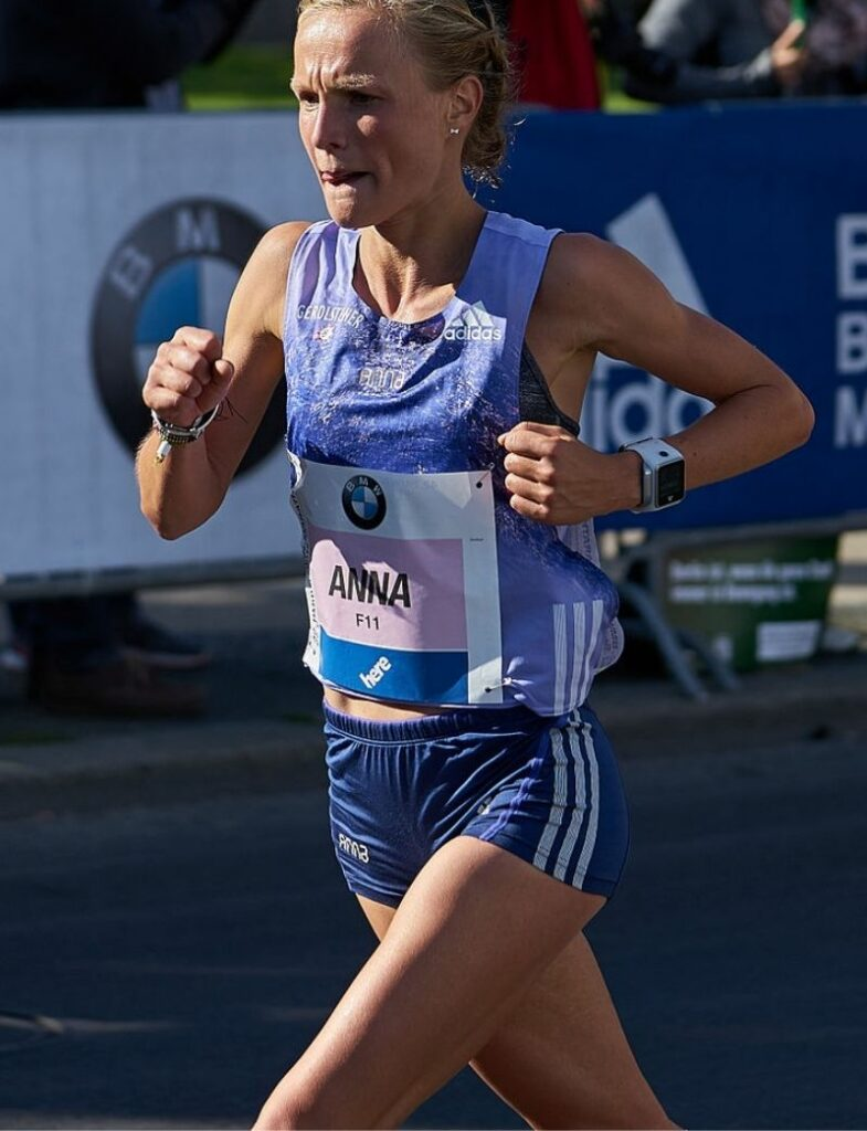 How-To-Run-For-A-Marathon-A-Great-Challenge-woman-near-finish-line