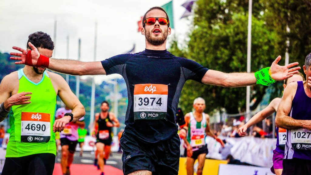 How-to-Train-For a-Marathon - 10-Tips-From-Top-Runners-happy-man-after-finishing-marathon