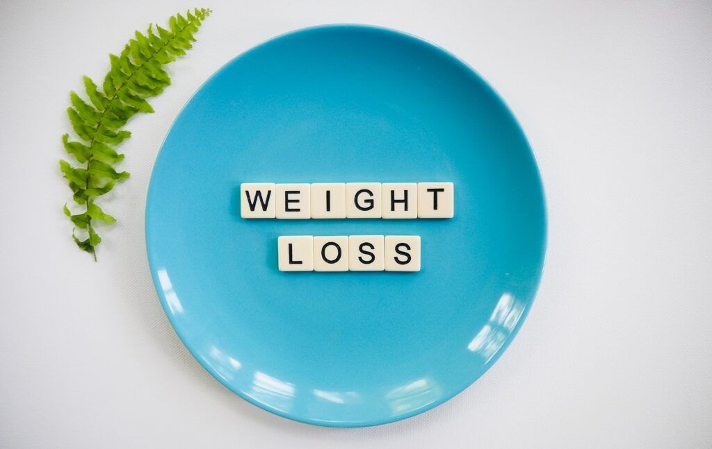How-to-Running-for-Weight-Loss-a-plate-with-weight-loss-written