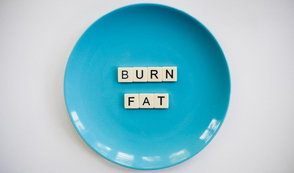 How-to-Running-for-Weight-Loss- a-plate-with-burn-fat-written