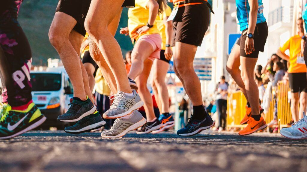 How-To-Evaluate-New-Running-Shoes-The-Valuable-Asset-runners-warming-up-before-start
