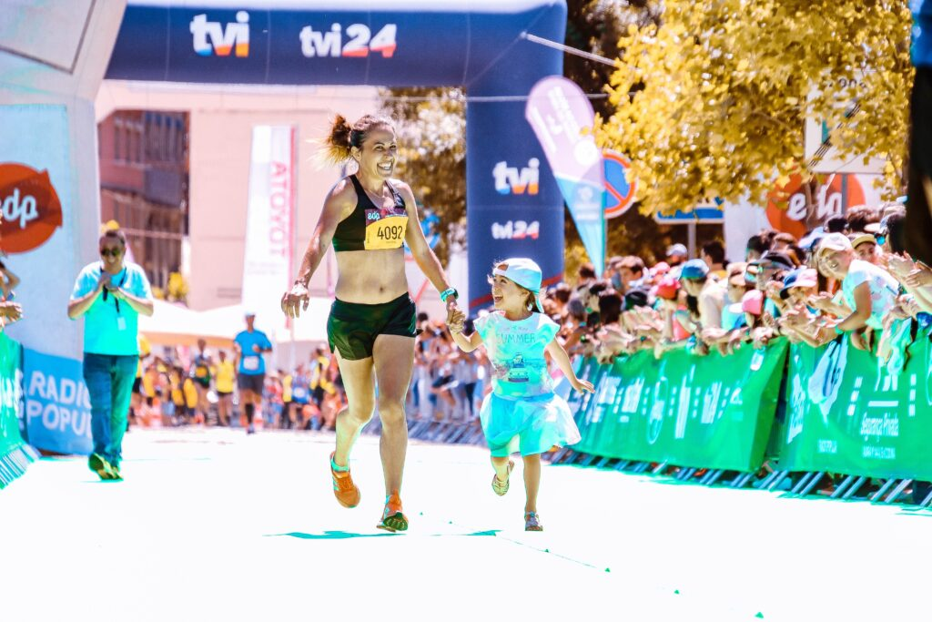 How-To-Raise-Your-Opportunities-With-Marathon-Training-Mother-And-Daughter-Hand-In-Hand-Cheering