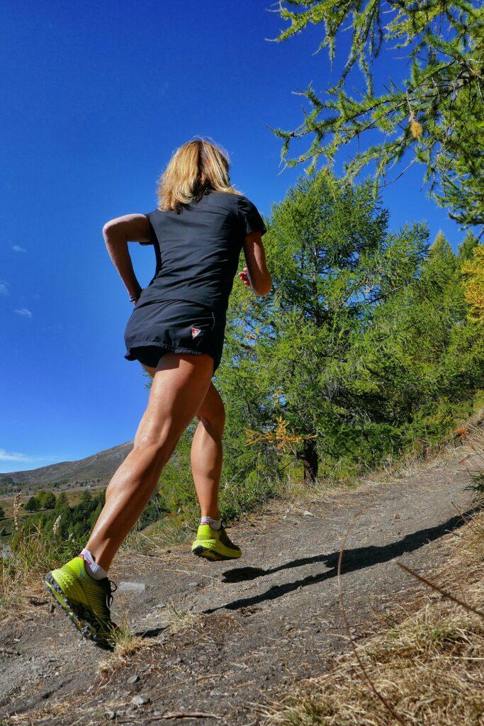 10-Instructive-Ways-For-Marathon-Training-Progress-woman-running-uphill