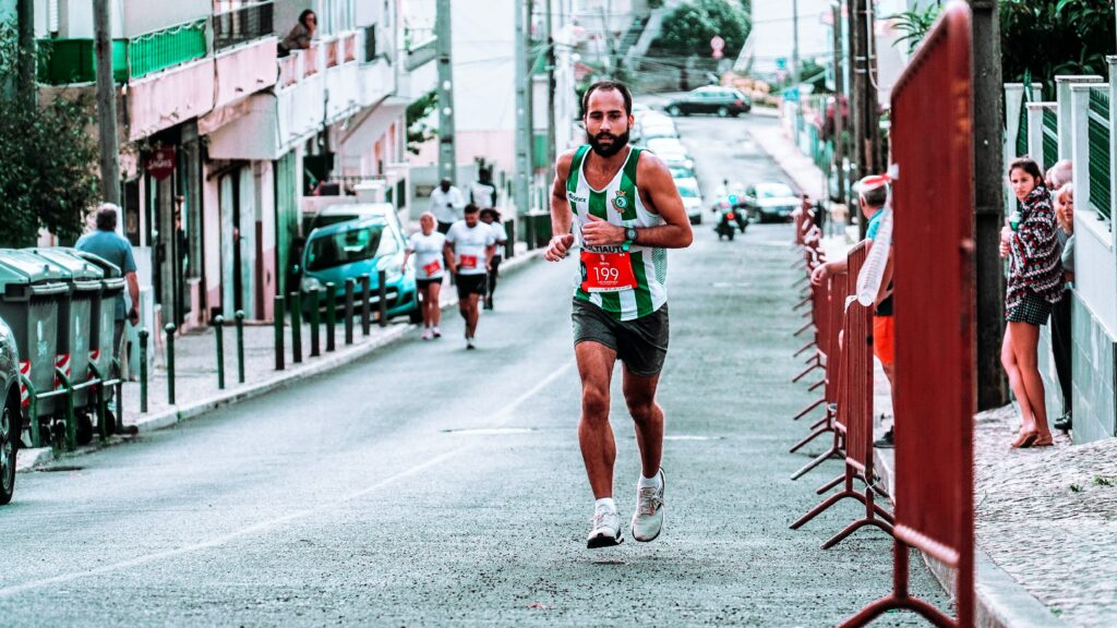 10-Instructive-Ways-For-Marathon-Training-Progress-man-in-a-marathon-race-running-uphill