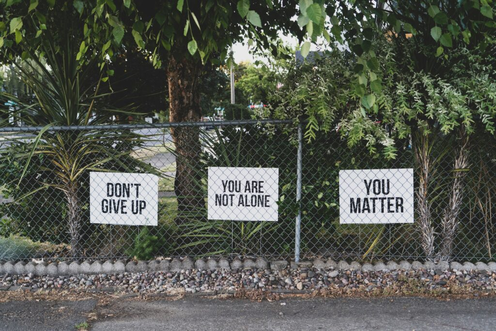 5-Best-informative-ways-to-recover-post-marathon-3-signs-hung-on-fences