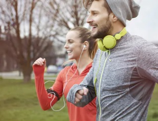 How-to-avoid-symptoms-of-chemical-imbalance-in-running-endorphins-man-and-female-smiling-while-running