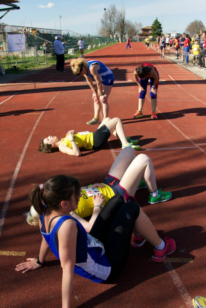 10-Informative-Training-tips - Makes-Breakthrough-In-A-Marathon-exhausted-female-runners-lies-down