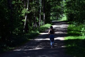 10-Informative-Training-tips - Makes-Breakthrough-In-A-Marathon-woman-running-on-a-forest-path