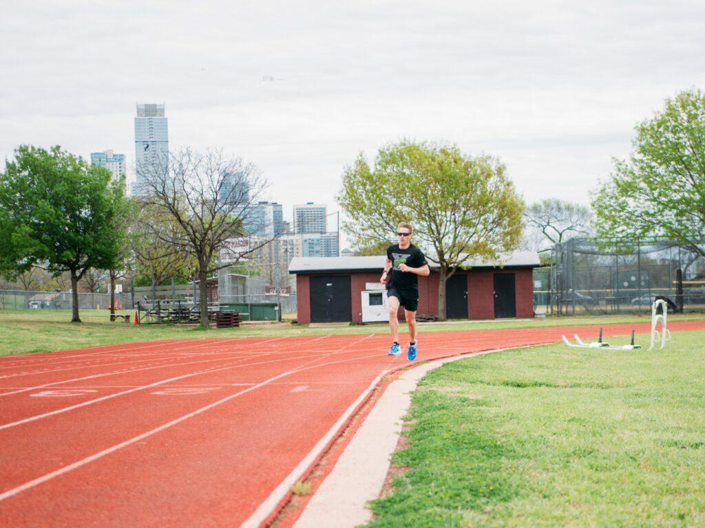 10-Informative-Training-Tips - Makes-Breakthrough-In-A-Marathon-man-running-alone-on-a-stadium