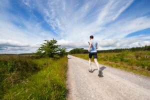 10-Informative-Training-tips - makes-Breakthrough-In-A-Marathon-man-running-in-the-open-air-on-a-gravel-path
