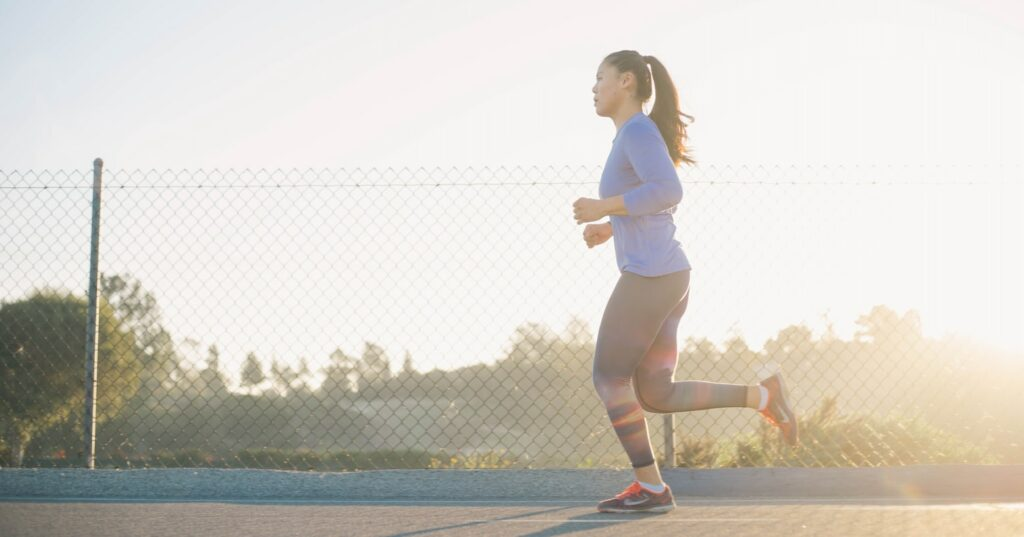 How-to-avoid-symptoms-of-chemical-imbalance-in-running- Woman-running-with-moderate-intensity