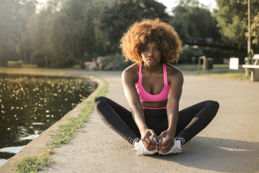 7-best-ways-preparing-a-marathon-race-and-complete-Woman-stretching-before-training