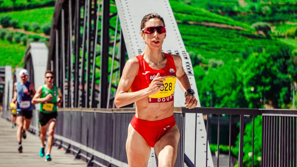 Marathon-Training-For-Elite-Run-2-Woman-in-a-Marathon-race-crossing-a-bridge