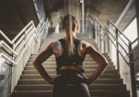 10-Motivational-Tips-to-Prepare-You-For-a-Marathon-female-in-front-of-stairs
