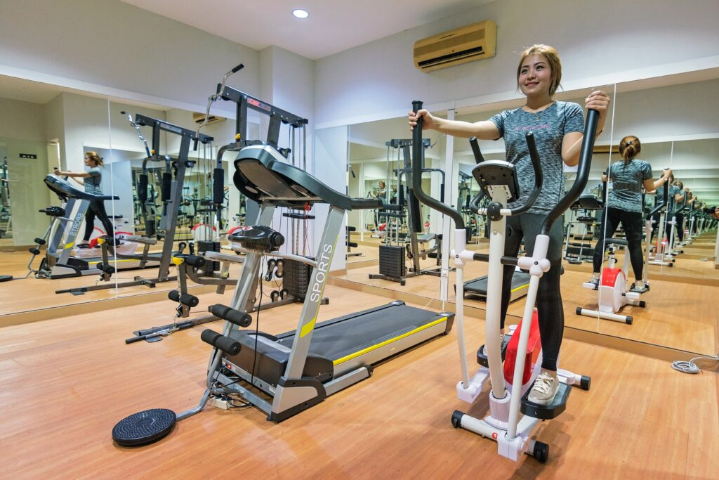 cross-training-running- Young-woman-in-Elliptical-trainer