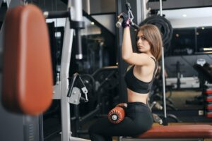 Quality-and-Strength-Benefits-of-Practical-Cross-Training-Woman-in-Lat-Pull-Down-exercise-machine