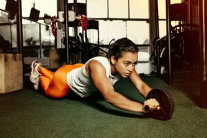 Quality-and-Strength-Benefits-of-Practical-Cross-Training-woman-ab-wheel-training