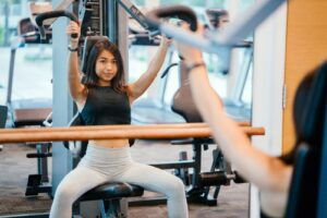 Quality-and-Strength-Benefits-of-Practical-Cross-Training-woman-in-fitness-machine