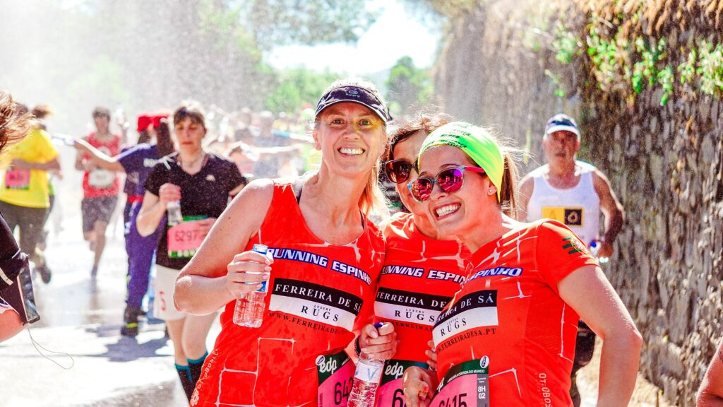 Ultimate-Marathon-Training-For-Beginners-group-of-3-women-post-marathon-enjoy-water