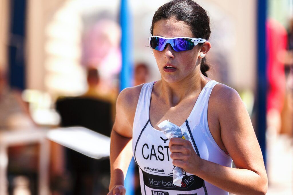 How-to-Train-For a-Marathon - 10-Tips-From-Top-Runners-female-runner-with-sunglasses