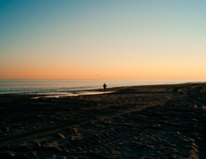 How-To-Experience-Wonderful-Flow-In-Running-Training-Male-Running-At-The-Beach