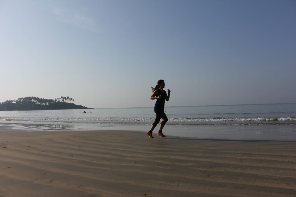 Training-To-Complete-a-Half-Marathon-With-Great-Motivation-Female-running-at-the-beach