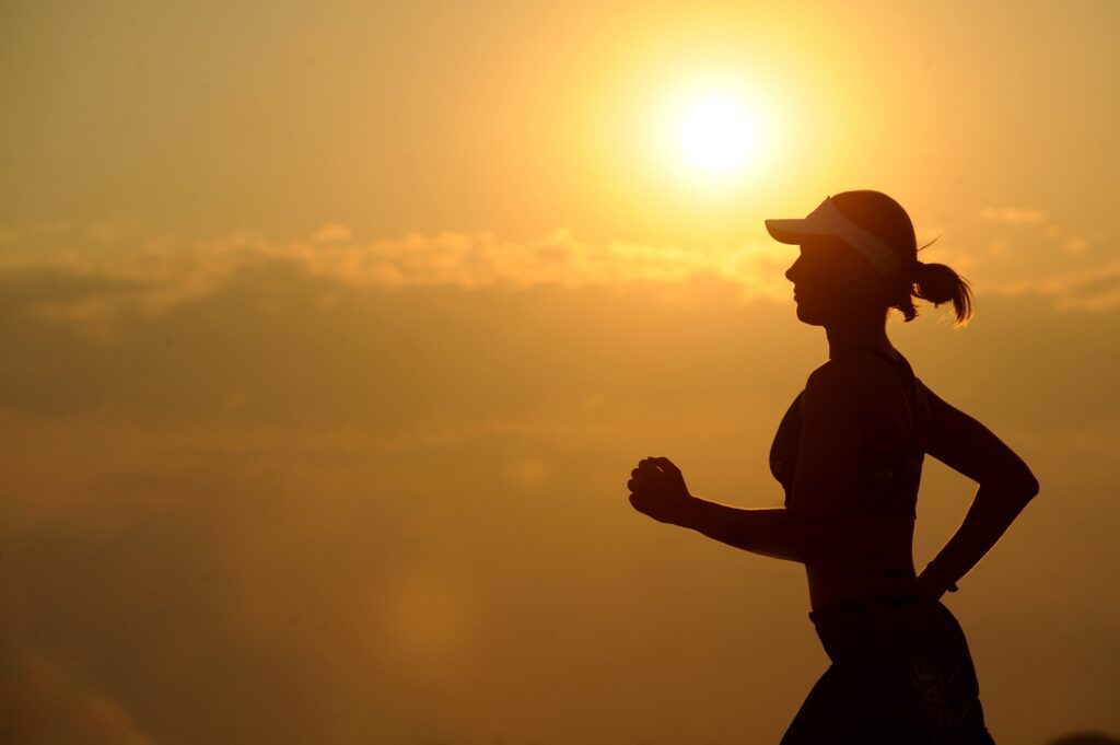Training-To-Complete-a-Half-Marathon-With-Great-Motivation-female-running-in-sunlight