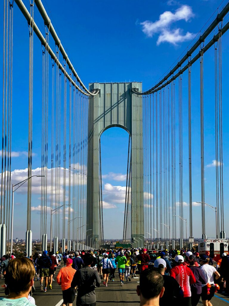 How-To-Run-Faster-And-Longer-With-Success-runners-at-a-bridge