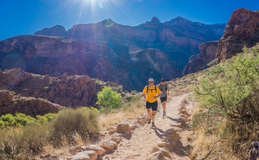 How-To-Run-Faster-And-Longer-With-Success-runners-at-mountain-road