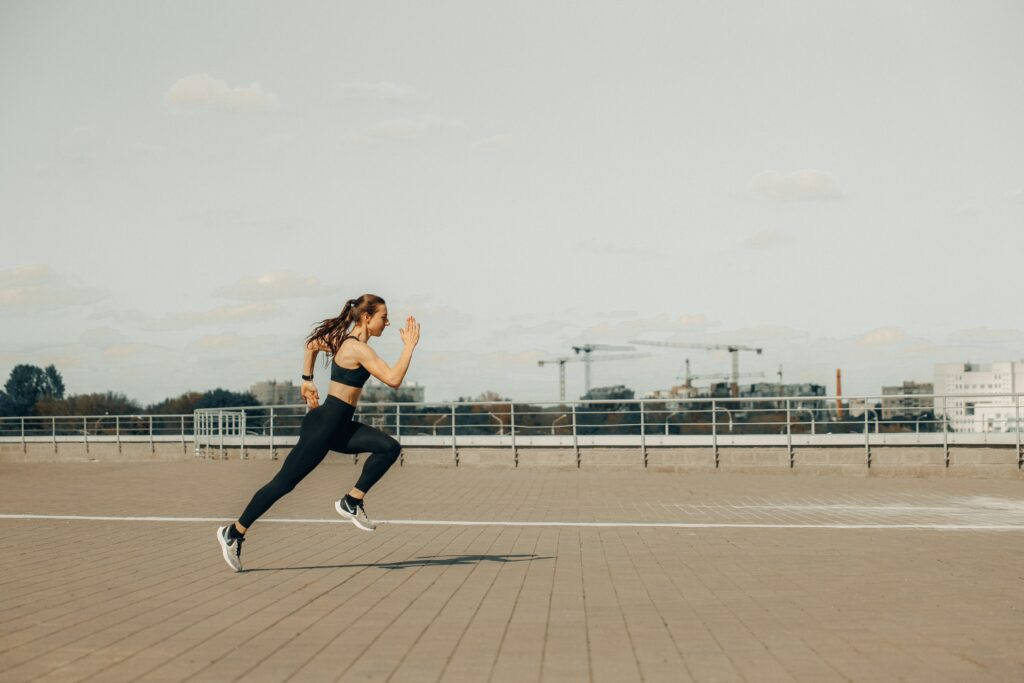 Best-Long-Distance-Running-Shoes-Woman-Running-on-concrete-stones-
